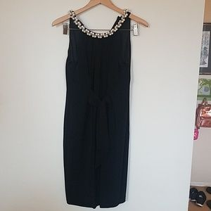 Black dress with faux pearl collar.